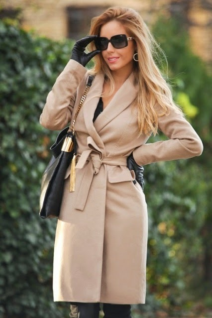 My hunch is Hugo Boss based on this image of this fashion blogger who listed her coat as Hugo Boss. The cut, pockets and seams are a good match for