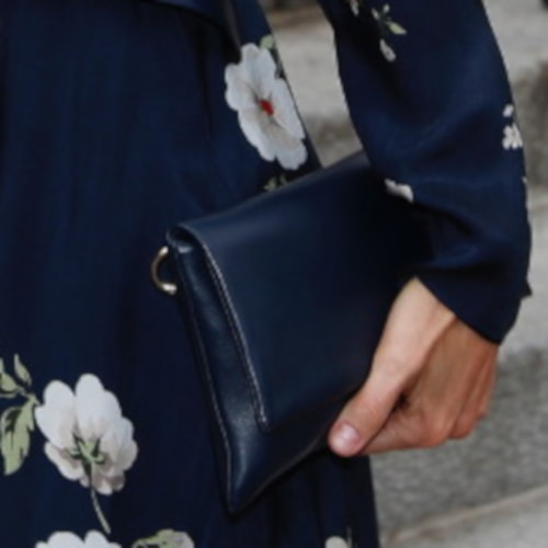 Queen Letizia carries Carolina Herrera 'Baret' navy leather clutch bag