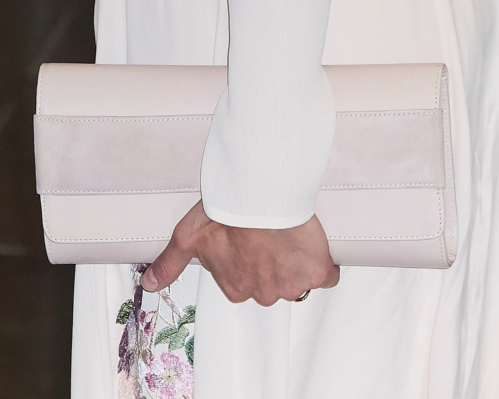 Queen Letizia carries dusty pink Magrit 'Ivy' suede clutch