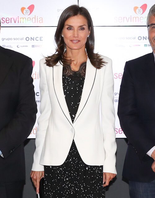 Queen Letizia wears white Carolina Herrera blazer with black piping