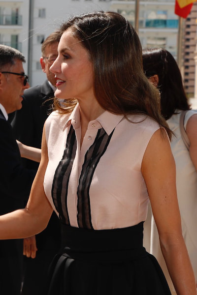 Queen Letizia wears Hugo Boss shell pink sleeveless blouse with ribbon trim