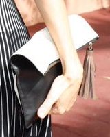 Carolina Herrera black and white tassel clutch bag