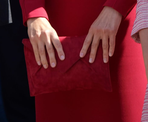 Magrit Kares clutch bag in red suede