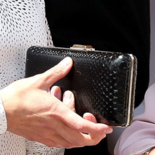 Queen Letizia carries black snakeskin box frame clutch