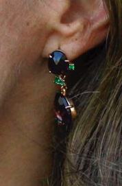 Pomellato Bahia drop earrings featuring amethyst with green tsavorite accent