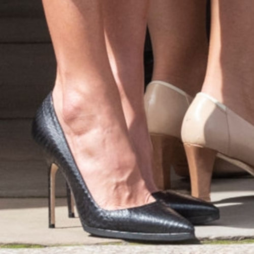 Queen Letizia wears Manolo Blahnik black snakeskin pumps